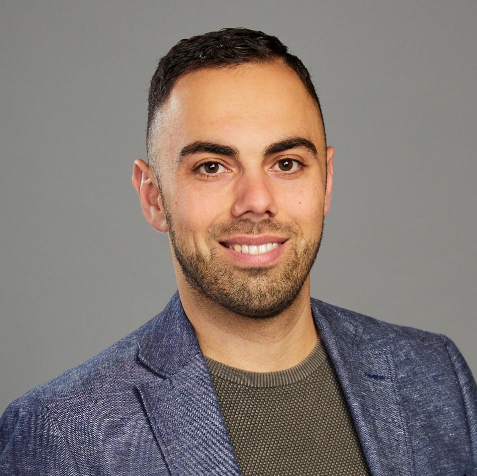 Headshot of Costa Vasili